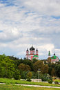 Majestic church towers feofaniya above the large green garde Stock Photography