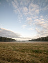 Majestic country landscape under morning sky with clouds. Royalty Free Stock Photo