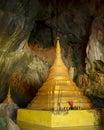 Majestic golden paya in sacred Yathaypyan Cave, Hpa-An, Myanmar. Royalty Free Stock Photo