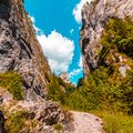 Majestic mountain scenery. sunny canyon, mountain path under in Royalty Free Stock Photo