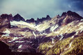 Majestic mountainous landscape beautiful high alps in summer covering with snow grunge style photo beauty of nature concept Stock Photography