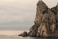 Majestic rocks by the sea at sunset stately big rock Royalty Free Stock Photos