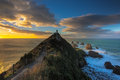 Majestic sunrise at the nugget point lighthouse new zealand Stock Images