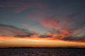 Majestic sunset in the summer sky with some clouds Royalty Free Stock Photos
