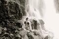 Majestic waterfall with dark rocks and blurry water flowing down davis creek in farmington utah Stock Photography
