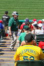 Major league baseball oakland as fan in a cespedes jersey an wearing bright yellow and green team with the name of s player yoenis Stock Image