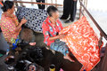 Make batik two old ladies on cloth with canting in solo Stock Photo