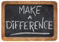 Make a difference motivational phrase white chalk handwriting on vintage slate blackboard Stock Photos