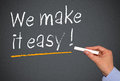 We make it easy blackboard with white chalk text message saying underlined in yellow Royalty Free Stock Image