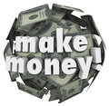Make money earn income profit revenue currency ball the words on a of hundred dollar bills to illustrate earning or through Royalty Free Stock Photo