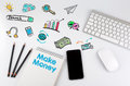 Make Money. Office desk table with computer, Smartphone, note pad, pencils Royalty Free Stock Photo