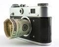 Camera and dollar Royalty Free Stock Photo