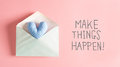 Make Things Happen message with a blue heart cushion