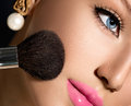 Make up applying closeup cosmetic powder brush for makeup Stock Photography