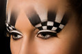 Make up art in the form of chessboard professional studio portrait on black background Royalty Free Stock Image