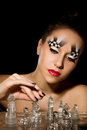 Make up art in the form of chessboard professional studio portrait on black background Royalty Free Stock Images