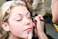 Make up artist applying eyebrow make up a Royalty Free Stock Photos