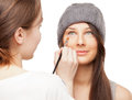 Make up artist applying makeup onto performer s face women isolated on white Royalty Free Stock Photography
