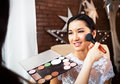 Make up artist doing make up for bride young beautiful applying wedding Royalty Free Stock Photo