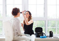 Make up artist doing make up for young beautiful bride applying wedding Stock Photography