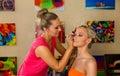 Make up artist at work applying make up on beautiful blond girl Royalty Free Stock Photos
