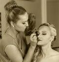 Make up artist at work applying make up on beautiful blond girl vintage Royalty Free Stock Photos