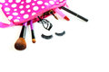 Make up bag with cosmetics and brushes isolated on white Royalty Free Stock Photography