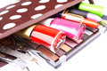 Make up bag with cosmetics and brushes on a white Stock Image