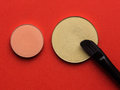 For Make-up. Bright shade with  brush on red background Royalty Free Stock Photo