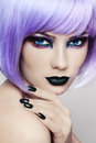 Make up close portrait of young beautiful woman with colorful fancy and violet wig Stock Photography
