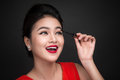 Make-up and cosmetics concept. Asian woman doing her makeup eyel Royalty Free Stock Photo