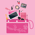 Make up cosmetics tools collection inside girls bag purse pouch pink color Royalty Free Stock Photo