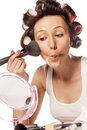 Make up and curlers happy housewife with applying makeup on her face Royalty Free Stock Images