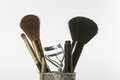 Make up and grooming tools and brushes close of some feminine Stock Photography