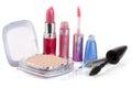 Make-up powder, lipstick, lip gloss eyeliner and mascara isolated on white background