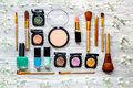 Make up set with decorative cosmetics on woman table background top view