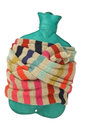 Make it warmer hot water bottle in scarf isolated on white cold and flu concept Stock Photo