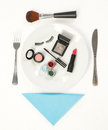 Makeup accessories on the dinner plate white Royalty Free Stock Photography