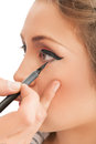 Makeup applying make up artist applying lipgloss Royalty Free Stock Photos
