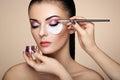 Makeup artist applies eye shadow Royalty Free Stock Photo