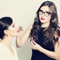 Makeup artist applying makeup fashion model woman beauty Royalty Free Stock Image