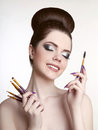 Makeup artist. Pretty teen girl with cute bun hairstyle and fash