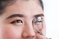 Makeup artist using eyelash curler on woman face Royalty Free Stock Photos