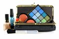Makeup bag with assorted cosmetics over a white background Royalty Free Stock Photo