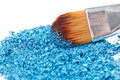 Makeup brush with blue crushed eye shadow Stock Photos