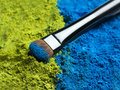 Makeup brush eye with eye shadow Stock Image