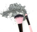 Makeup brush with gray color eyeshadow powder. Royalty Free Stock Photo