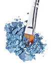 Makeup brush with grey blue crushed eye shadow Royalty Free Stock Photo
