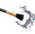 Makeup brush with mixed color eyeshadow powder. Royalty Free Stock Photo