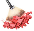Makeup brush with red crushed eye shadow Stock Photos